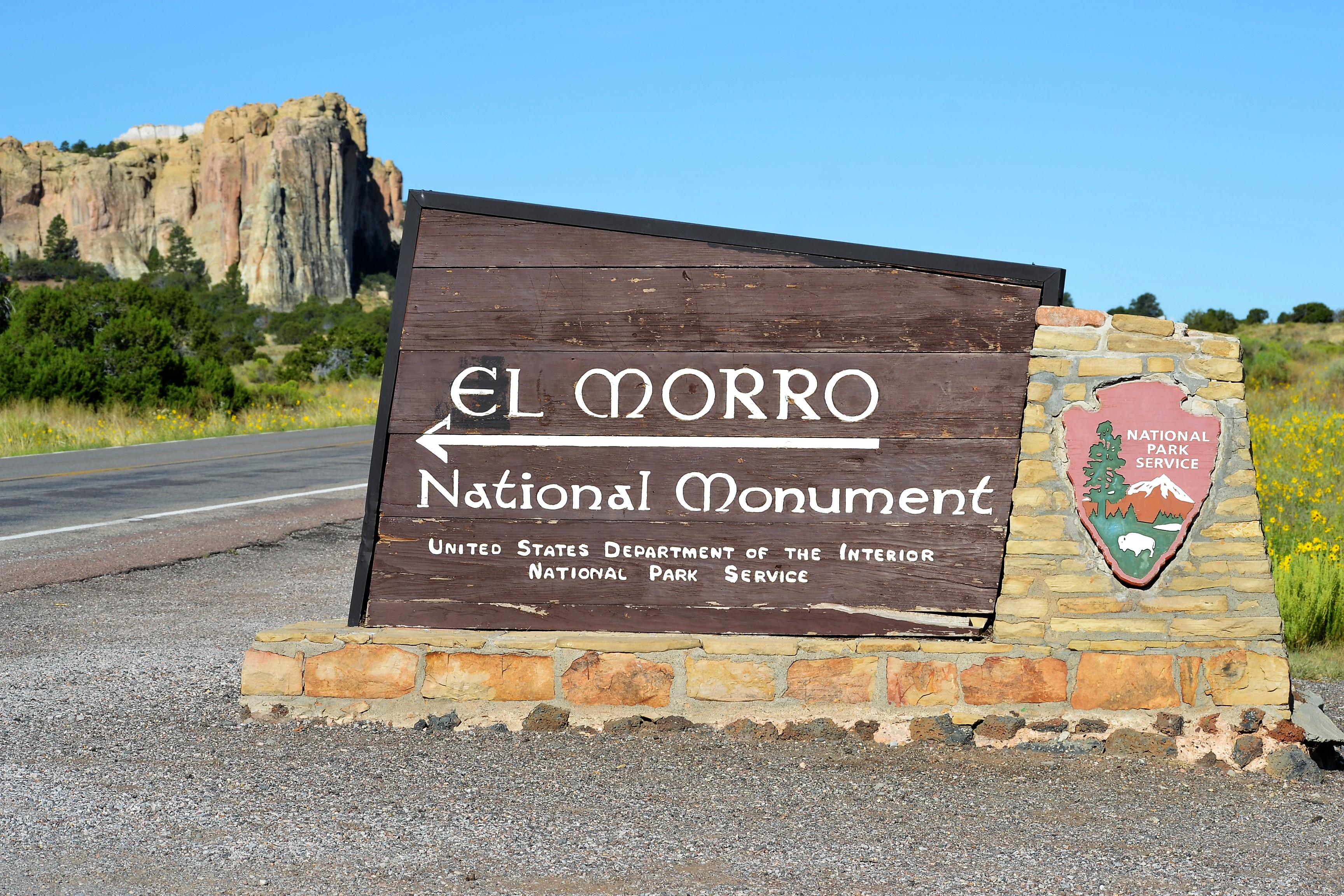 Entrance Sign With El Morro in the Background